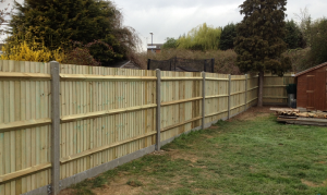 Closeboard fence with concrete posts & concrete gravel boards
